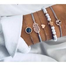 #09 - Wit / Grijs armband met schildpad - wereldbol - hartje - steentje - ananas  5-delige armband